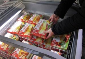 A customer takes a pack of Findus Beef Hachis Parmentier in a freezer of a supermarket in Nice, southeastern France, Monday, Feb. 11, 2013.