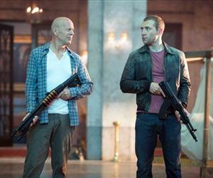 This film image released by 20th Century Fox shows Bruce Willis as John McClane, left, and Jai Courtney as his son Jack in a scene from A Good Day to Die Hard.