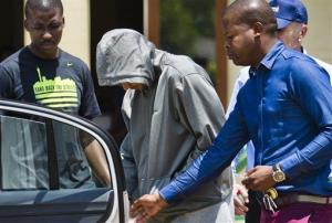 Olympic athlete Oscar Pistorius leaves the Boschkop police station, east of Pretoria, South Africa, Thursday, Feb. 14, 2013.