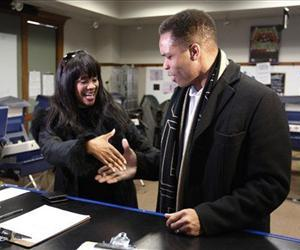 Then-US Rep. Jesse Jackson Jr.,and his wife, Sandi, arrive at a polling station for early voting, March 9, 2012.