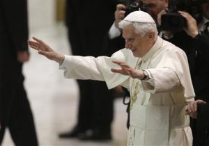 Pope Benedict XVI leaves after an audience with the Roman clergy in the Paul VI Hall at the Vatican Thursday.