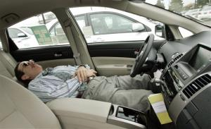 A Prius owner checks the reclining driver's seat in a Prius gasoline-electric hybrid at Power Toyota in Cerritos, Calif., Wednesday, Jan. 23, 2008.