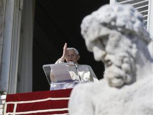 Pope Benedict XVI blesses the faithful from his window overlooking St.Peter's Square during the Angelus prayer, Sunday, Feb. 10, 2013.