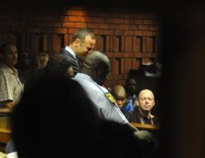 Oscar Pistorius reacts in court in Pretoria, South Africa, Friday, Feb 15, 2013, at his bail hearing in the murder case of his girlfriend Reeva Steenkamp.