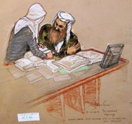 The self-proclaimed terrorist Khalid Sheikh Mohammed, right, talks with a female member of his legal team at the Guantanamo Bay US Naval Base in Cuba, Tuesday, Feb. 12, 2013.