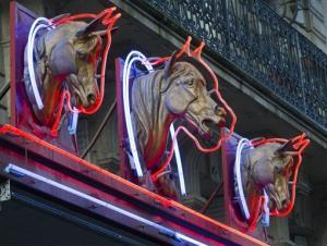 Statues of horses' heads above a horsemeat butcher shop  in Paris.