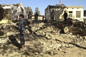 Afghan security forces investigate the scene after two suicide attacks in Spin Boldak, Kandahar province, south of Kabul, Afghanistan, Sunday, Jan. 6, 2013.