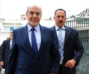 Tunisian Prime Minister Hamadi Jebali, followed by a body guard, arrives for a meeting with representatives of all Tunisian political parties in Carthage, Feb. 18, 2013.