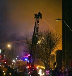 Firefighters battle a massive fire at the Country Club Plaza in Kansas City, Mo.