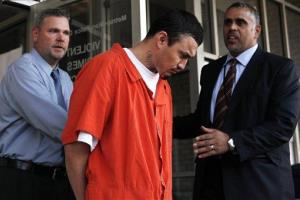 In this April 22, 2009 file photo, 27-year-old Ingmar Guandique, center, accused of killing Washington intern Chandra Levy, is escorted from the Violent Crimes Unit in Washington by detectives.
