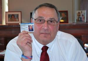 In this photo tweeted by Gov. Paul LePage, the Maine governor displays his concealed firearms permit, Tuesday, Feb. 12, 2013, in Augusta, Maine.