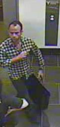 This image provided by the New York Police Department shows a surveillance camera image of a man suspected of stealing a Salvador Dali painting from a Manhattan art gallery Thursday, June 21, 2012.
