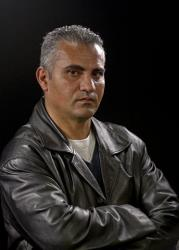 Documentary film director Palestinian Emad Burnat poses for a photo after an interview in Los Angeles, Tuesday, Feb. 5, 2013.