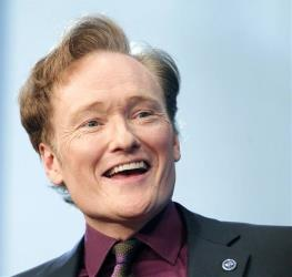 In this 2012 file photo, Conan O'Brien speaks at the John F. Kennedy Presidential Library in Boston.