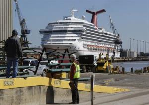 Workers look in the direction of the cruise ship Carnival Triumph in Mobile, Ala., Friday, Feb. 15, 2013.