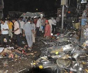 People gather on the scene after a bomb blast in Hyderabad, India, Feb.21, 2013.