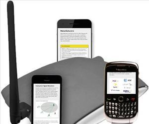 A wireless signal booster is seen surrounded by phones in this government handout illustration.