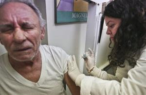 A senior gets a flu shot in Brooklyn last month.