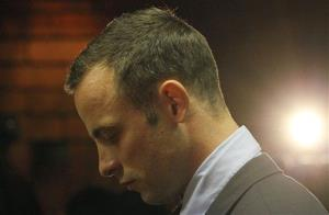 Oscar Pistorius stands in the dock during his bail hearing.