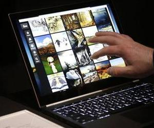 A man uses the Google Chromebook Pixel laptop computer after an announcement in San Francisco, Thursday, Feb. 21, 2013.