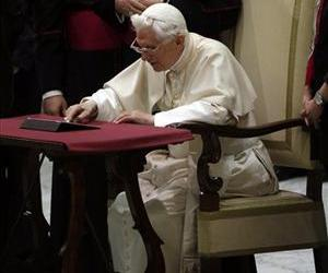 Pope Benedict XVI pushes a button on a tablet at the Vatican, Dec. 12, 2012.
