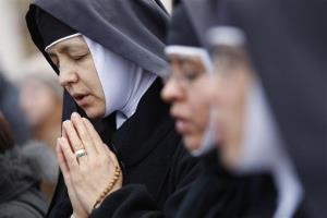 Nuns pray prior to Pope Benedict XVI's last Angelus noon prayer, Sunday, Feb. 24, 2013. The last chance for a Sunday blessing from Benedict is drawing a crowd.