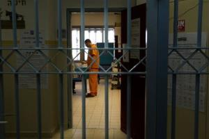 A prisoner casts his vote during legislative elections in the Rimonim prison, central Israel,Tuesday, Jan. 22, 2013.