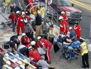 Injured spectators are treated after a crash at the conclusion of the NASCAR Nationwide Series auto race Saturday, Feb. 23, 2013, at Daytona International Speedway in Daytona Beach, Fla.