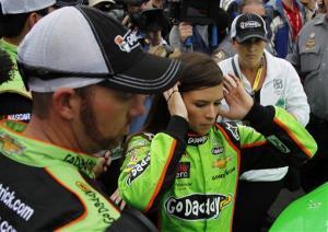 Danica Patrick, center, prepares to get in her car at the NASCAR Daytona 500 Sprint Cup Series auto race at Daytona International Speedway, Sunday, Feb. 24, 2013, in Daytona Beach, Fla.