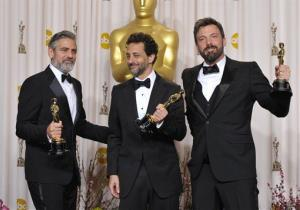 George Clooney, from left, Grant Heslov, and Ben Affleck pose with their awards for best picture for Argo during at the Oscars at the Dolby Theatre on Sunday, Feb. 24, 2013, in Los Angeles.