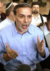 In this file photo of  March 14, 2005, New York State Assemblyman Dov Hikind speaks to the media at the Ben Gurion airport near Tel Aviv, Israel.