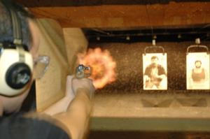 A man firing at a gun range.