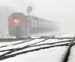 A BNSF train engine waits for another train to pass, Monday, Feb. 25, 2013, along Lorraine Street, just northeast of Avenue A in Hutchinson, Kan.
