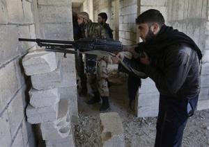 Free Syrian Army fighters take their positions in Idlib province, Syria, Tuesday.