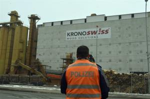 A police stands in front of a wood-processing company in Menznau, central Switzerland, Wednesday, Feb. 27, 2013, where several people were killed in a shooting. Police in Lucerne canton (state) said in a statement that the shooting occurred shortly after 9 a.m. at the premises of Kronospan, a company...