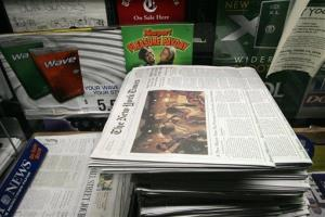 Copies of The New York Times are for sale in this Oct. 19, 2006 file photo in New York.