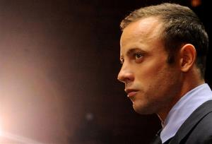 In this photo taken Feb. 22, 2013 Olympic athlete, Oscar Pistorius, in court in Pretoria, South Africa, for his bail hearing charged with the shooting death of his girlfriend, Reeva Steenkamp.