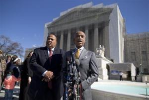 The Rev. Al Sharpton, right, and Martin Luther King III meet with reporters outside the Supreme Court in Washington Wednesday.