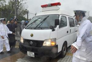 In this Wednesday, Oct. 17, 2012 photo, a police vehicle carrying Christopher Browning of Athens, Texas, leaves Okinawa prefectural police station in Ginowan in Okinawa, southern Japan.