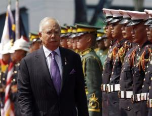 Malaysian Prime Minister Najib Razak reviews troops during a welcoming ceremony at Malacanang Palace grounds in Manila, Philippines, Monday Oct. 15, 2012.