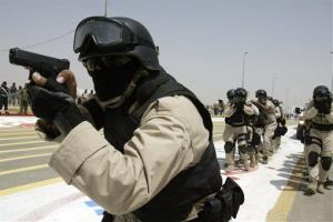 Iraqi security forces show their skills during a province handover ceremony in Diwaniyah, Wednesday, July 16, 2008.