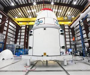 The Dragon spacecraft is seen inside a processing hangar at Cape Canaveral Air Force Station in Cape Canaveral, Fla. last month, after teams installed the spacecraft's solar array fairings.