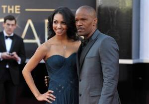 Actor Jamie Foxx, right, and daughter Corinne Bishop arrive at the Oscars at the Dolby Theatre on Sunday Feb. 24, 2013, in Los Angeles.