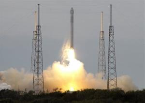 The SpaceX rocket lifts off from the Cape Canaveral Air Force Station Friday.
