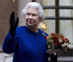 In this Tuesday, Dec. 18, 2012 file photo, Britain's Queen Elizabeth II waves as she ends an official visit which is part of her Jubilee celebrations in London.