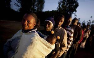 Kenyans line up to cast their vote in a general election at the Mutomo primary school near Gatundu, north of Nairob.