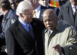 Vice President Joe Biden embraces Rep. John Lewis, D-Ga., as they prepare to lead a group across the Edmund Pettus Bridge in Selma, Ala.