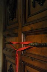 A red ribbon seals the door of the apartment of Pope Benedict XVI's Vatican apartment.