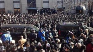 A crowd is gathered in front of the Brooklyn, New York, synagogue where funeral services were held Sunday, March 3, 2012, for expectant parents Nachman and Raizy Glauber, both 21.