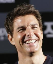 Tom Cruise smiles during a news conference to promote his film Jack Reacher in Seoul, South Korea, Thursday, Jan. 10, 2013.